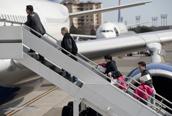 passengers boarding the aircraft